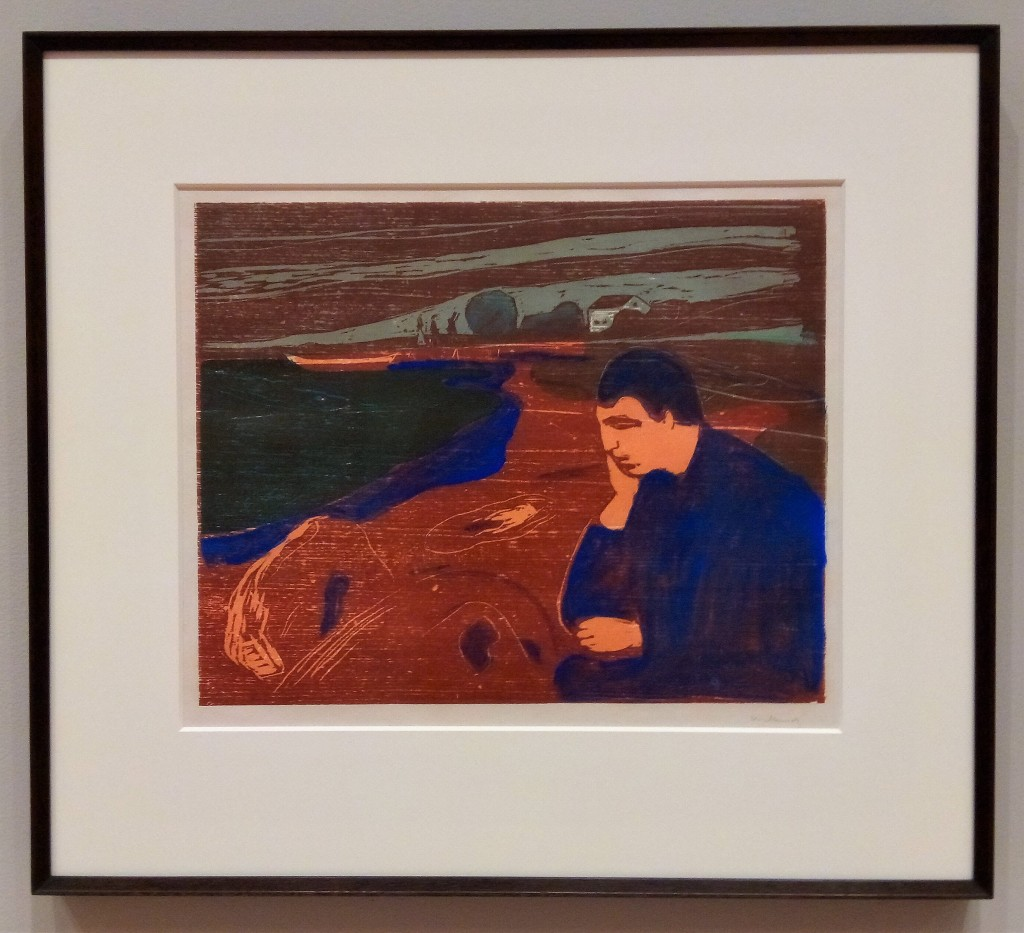 photo of a woodcut print. a melancholy man sits head in hand at the water's edge. edvard munch