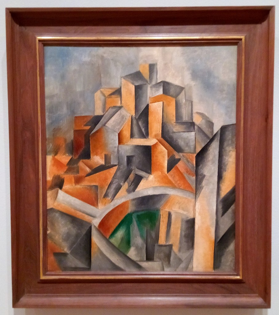 photo of a cubist landscape by picasso. stacks of buildings on top of each other, all angles and shading