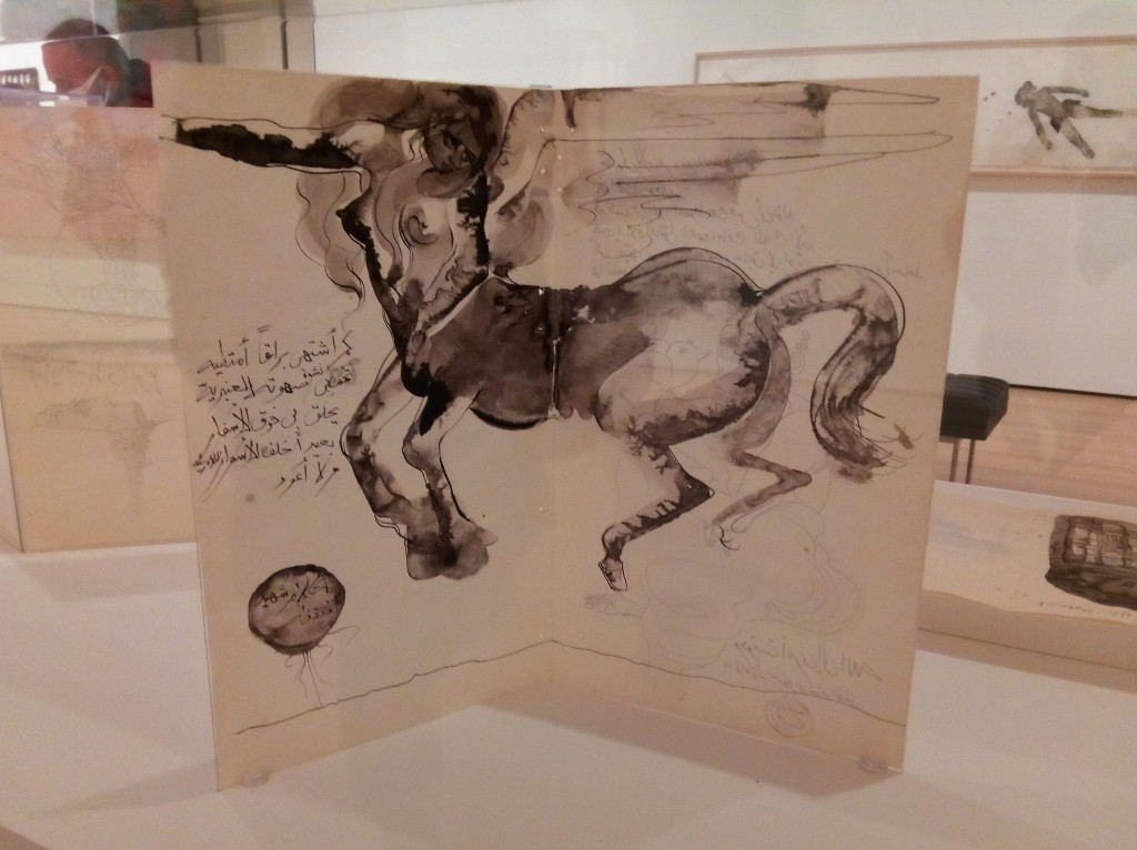 black and white ink/watercolor  of a lady  centaur, in mid buck, across the interior spread of a paper bi-fold
